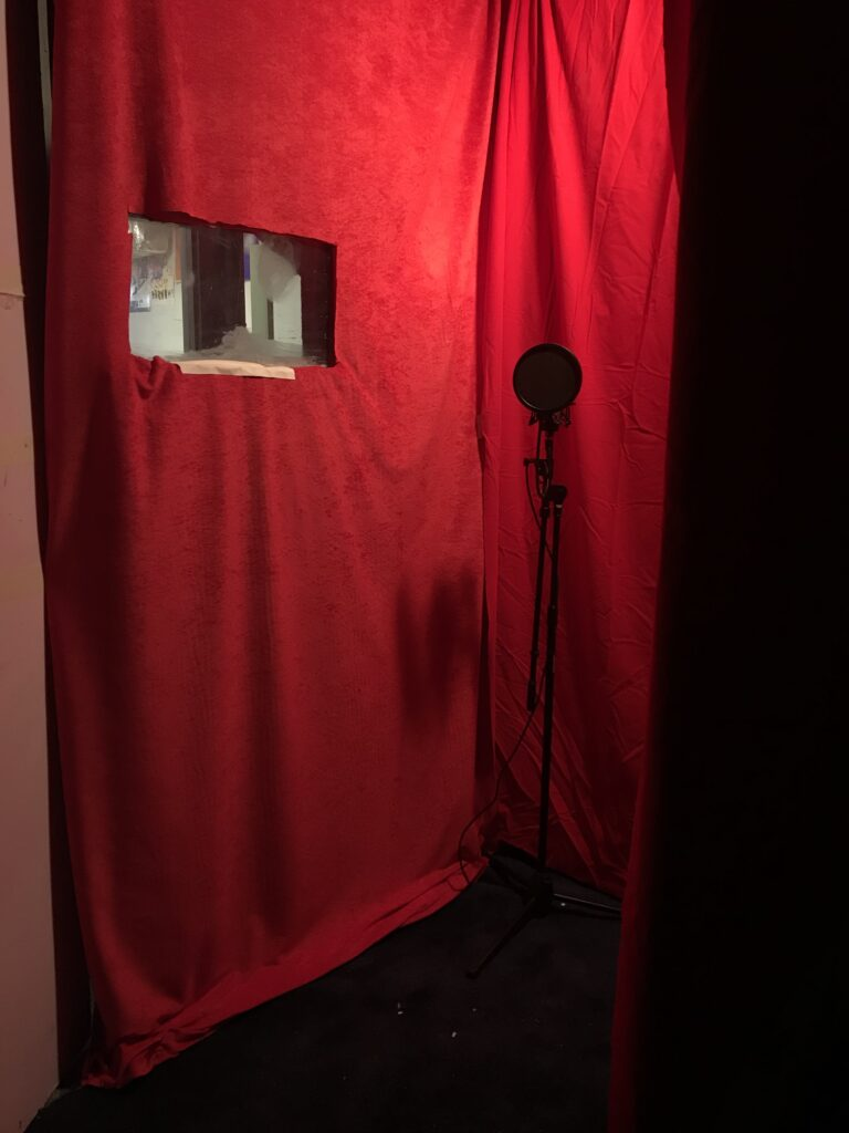 Red fabric with a microphone in front of it